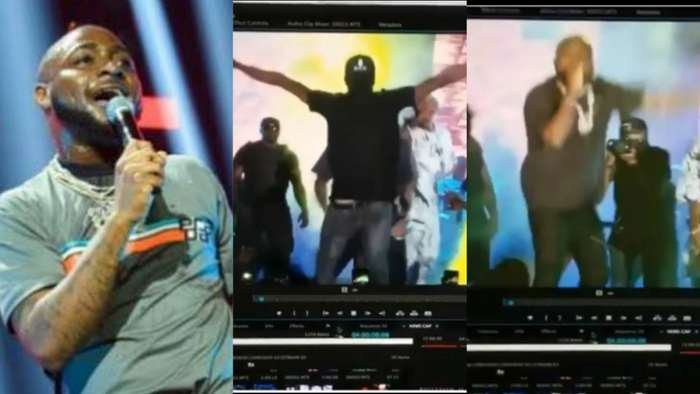 Music star, Davido abruptly dodged a fan who jumped on stage to hug him (video)